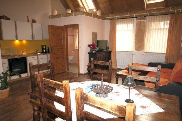 Warnemünde Ferienwohnung Sevilla Wohnzimmer mit Esstisch