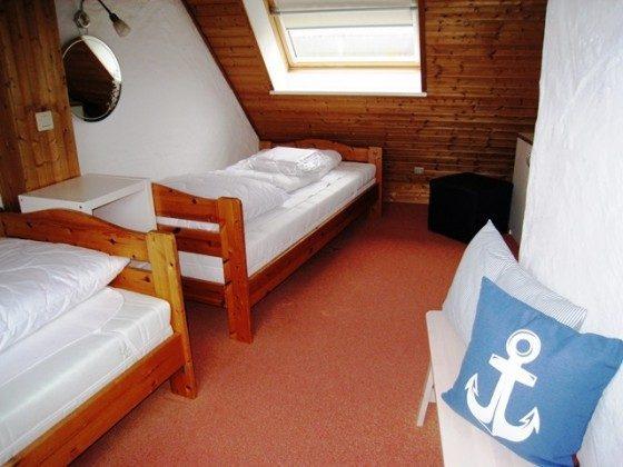 Schlafzimmer Nr. mit 3 Einzelbetten im DG