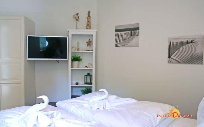 Schlafzimmer mit extra Fernseher Ferienwohnung Am Strand 2 A 2.22