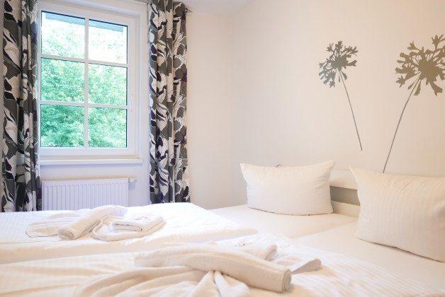 Schlafzimmer Ferienwohnung Möwenruf A 2.25 Haus Meeresblick