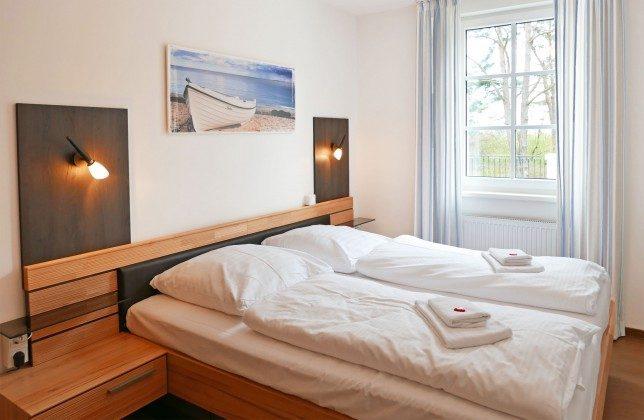 Schlafzimmer Ferienwohnung Dünenblick A 0.06