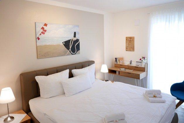 """Schlafzimmer Baabe, Ferienwohnung 43 """"Lebensfreude"""" Ref. 211411"""
