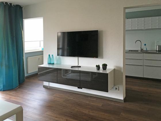 """Apartment """"KlarSchiff"""" Ref. 177870 - Wohnbereich mit TV"""