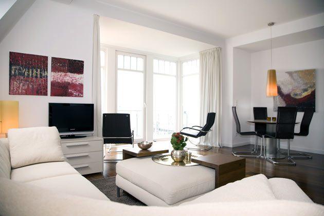 Wohnzimmer Ferienwohnung mit Meerblick in Warnemünde