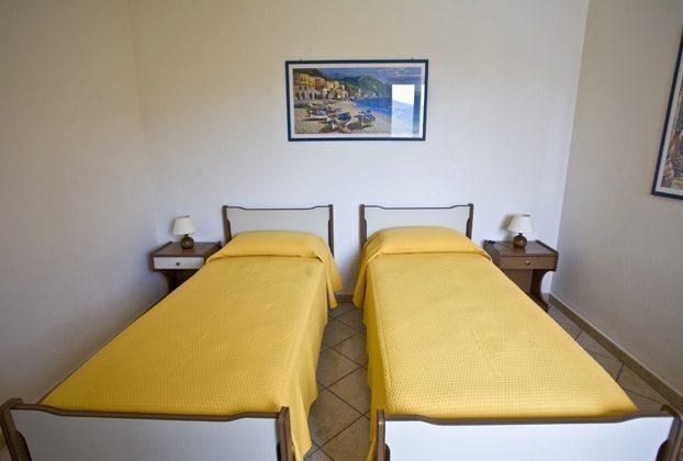Schlafzimmer a Ferienwohnung Elba Villino Forno 2598-29