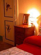 Apartment 1: Geranio Schlafzimmer