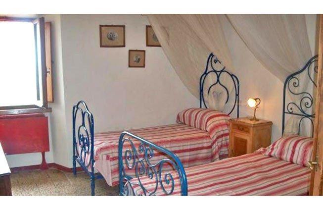 Schlafzimmer 1 Marsiliana Ferienwohnung 22649-8