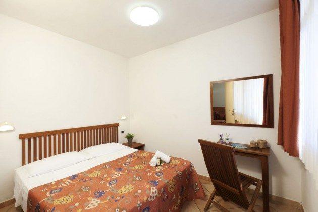 Schlafzimmer des Bungalows Giglio