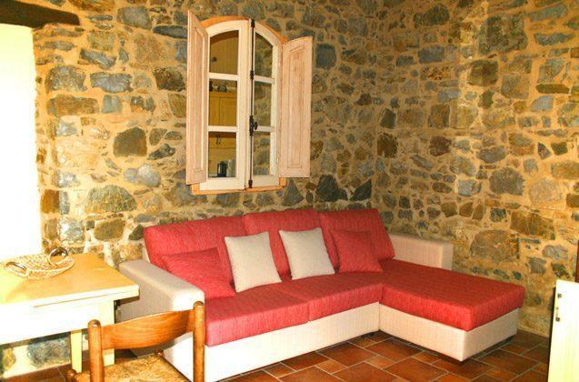 Ferienwohnung Rustico - Wohnraum mit Natursteinmauern