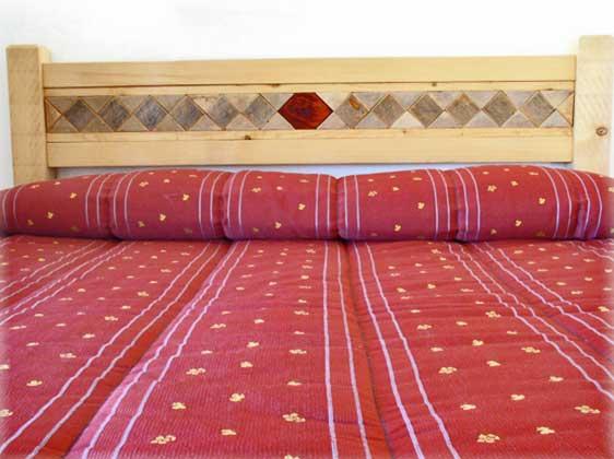 Ferienwohnung-2223-Il-Glicine-Schlafzimmer-mit-Doppelbett