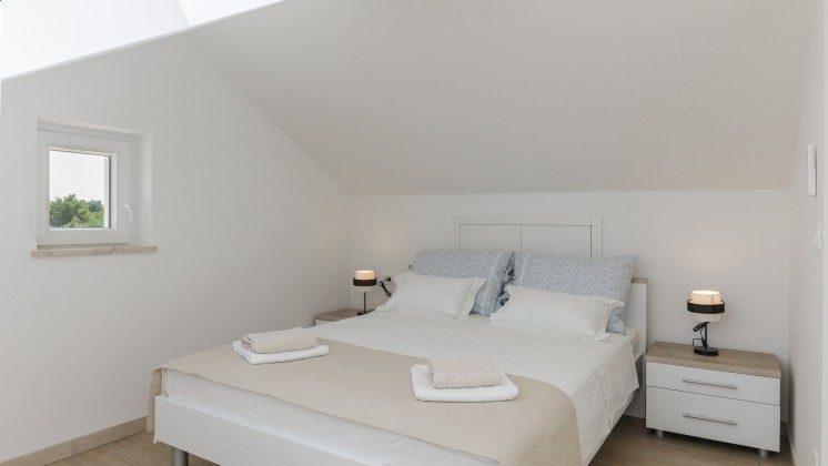 Schlafzimmer 1 im Obergeschoss - Objekt 138495-37