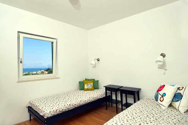 Schlafzimmer mit 2 Einzelbetten im Erdgeschoss