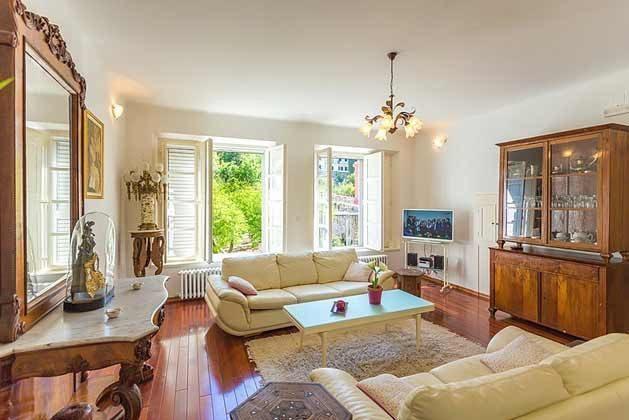 Wohnzimmer mit Blick in den Garten - Bild 1- Objekt 94599-48