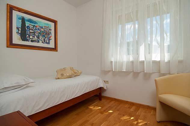 A  Schlafzimmer 3 mit Einzelbett