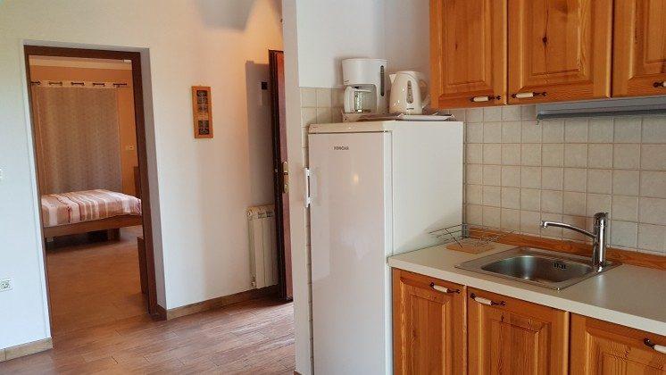 Wohnküche und Blick ins Schlafzimmer - Objekt 160284-242