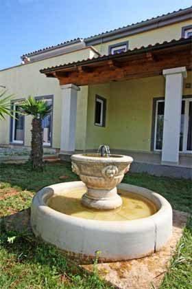 Springbrunnen im Garten