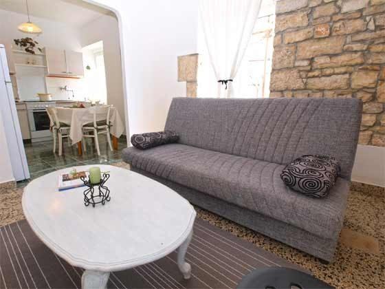 Wohnzimmer mit Durchgang zur Küche - Objekt 160284-259