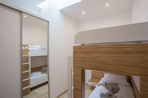Apartment 4+1 Schlafzimmer mit Etagenbett