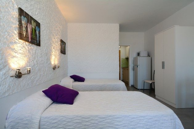 FUE 110068-56 Wohnbeispiel Schlafbereich mit Schrank