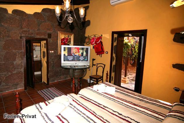 Schlafzimmer Apartment mit Flatscreen-TV