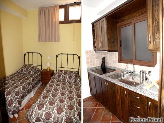 Schlafzimmer mit Einzelbetten und Küche Wohnung A