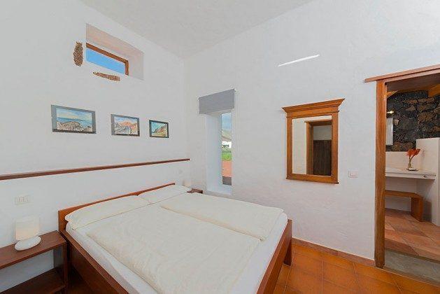 Schlafzimmer mit Doppelbett, Wohnung 3 Hibiscus