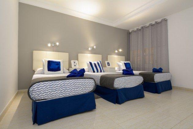 weiteres Foto Schlafraum mit drei Einzelbetten