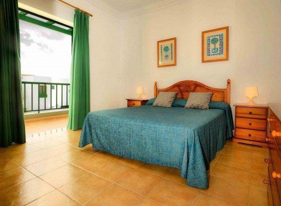 LZ 144288-31 Wohnbeispiel Schlafzimmer mit Doppelbett und Balkon