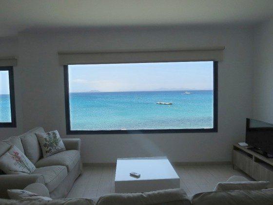 Panoramafenster im Wohnbereich mit Meerblick