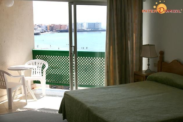 Wohnbeispiel Doppelzimmer mit Balkon und Meerblick