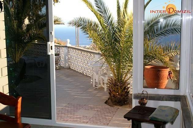 verglaste Veranda mit Blick auf die Küste